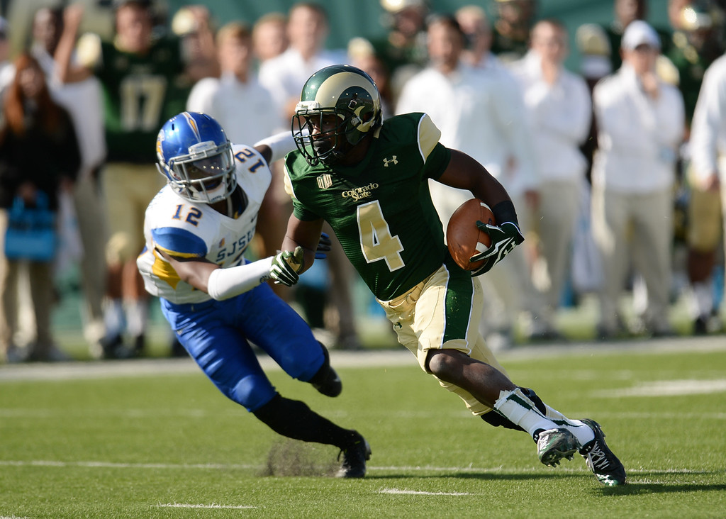 . FORT COLLINS, CO - OCTOBER 12 : Charles Lovett of Colorado State (4) controls the ball against Forrest Hightower of San Jose State (12) in the 2nd quarter of the game at Hughes Stadium. Fort Collins. Colorado. October 12, 2013. San Jose won 34-27. (Photo by Hyoung Chang/The Denver Post)