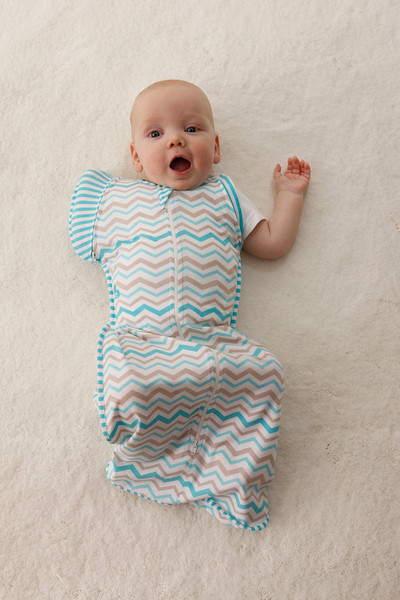Love_To_Dream_Stage_2_5050_Zigzag_Turquoise_Lifestyle_Baby_Arm_Out_Mouth_Open.jpg
