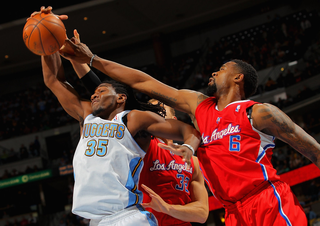 . DENVER, CO - MARCH 07:  Kenneth Faried #35 of the Denver Nuggets grabs a rebound away from Blake Griffin #32 of the Los Angeles Clippers and DeAndre Jordan #6 of the Los Angeles Clippers at the Pepsi Center on March 7, 2013 in Denver, Colorado.  (Photo by Doug Pensinger/Getty Images)