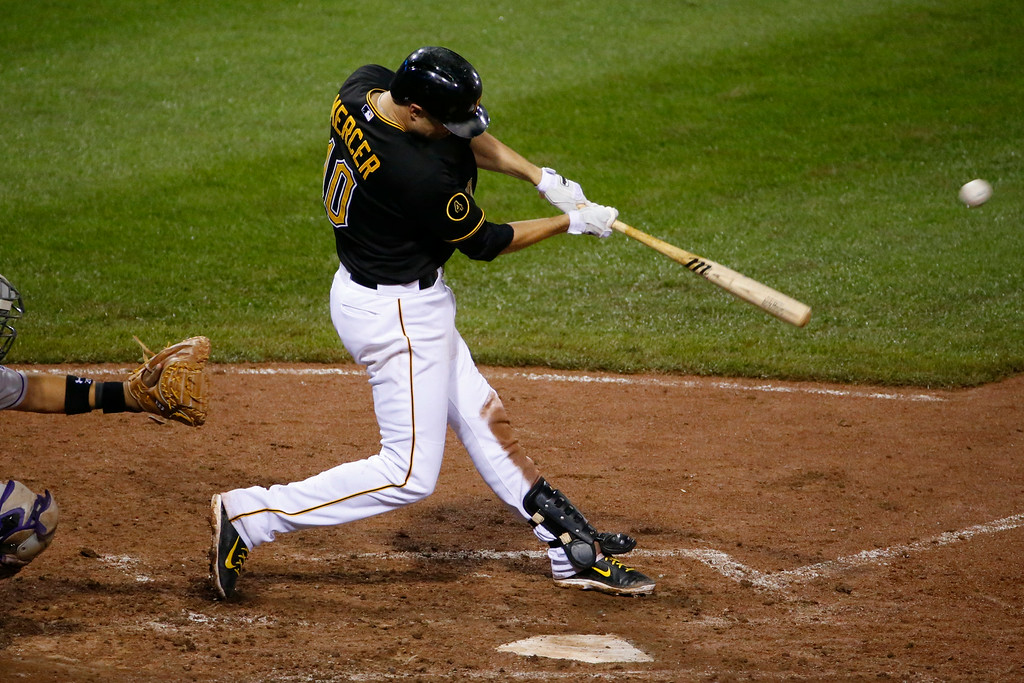 . Pittsburgh Pirates\' Jordy Mercer hits a walk off double off Colorado Rockies relief pitcher Chad Bettis during the 11th inning of a baseball game in Pittsburgh Saturday, July 19, 2014. The Pirates won in 3-2 in 11 innings. (AP Photo/Gene J. Puskar)