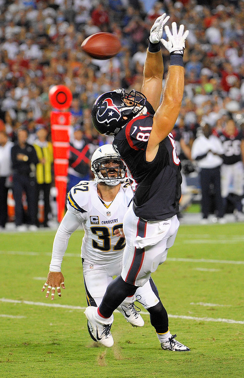 . Houston Texans tight end Owen Daniels can\'t get his hands on a pass as San Diego Chargers free safety Eric Weddle looks on during the first half of an NFL football game Monday, Sept. 9, 2013, in San Diego. (AP Photo/Denis Poroy)