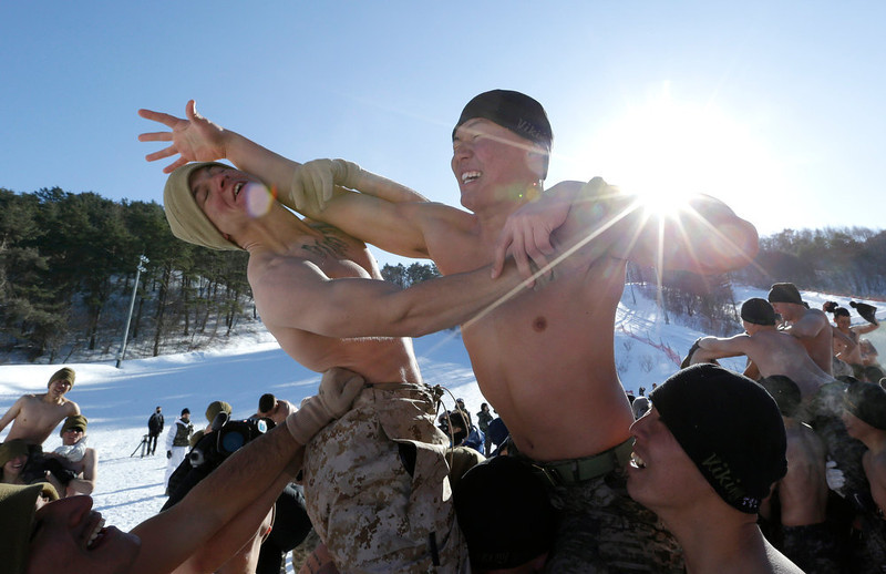 . A South Korean Marine, right and a U.S. Marine from 3-Marine Expeditionary Force 1st Battalion from Kaneho Bay, Hawaii, left, play a mock cavalry battle during their joint military winter exercise in Pyeongchang, east of Seoul, South Korea, Thursday, Feb. 7, 2013. More than 400 marines from the two countries participated in the Feb. 4-22 joint winter exercise held for the first time in South Korea. (AP Photo/Lee Jin-man)