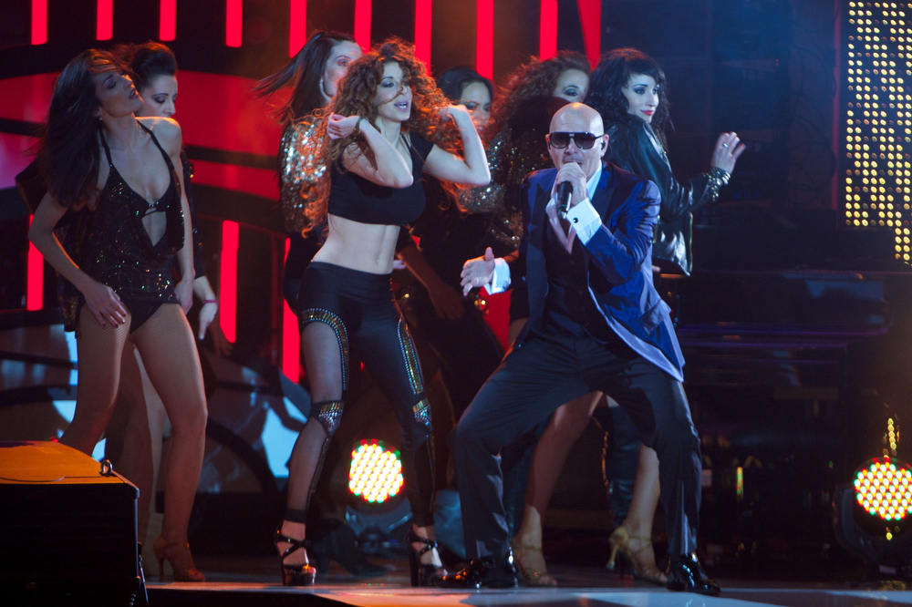 "Description of . Pitbull performs on stage during ""40 Principales Awards\"" 2012 at Palacio de los Deportes on January 24, 2013 in Madrid, Spain.  (Photo by Carlos Alvarez/Getty Images)"