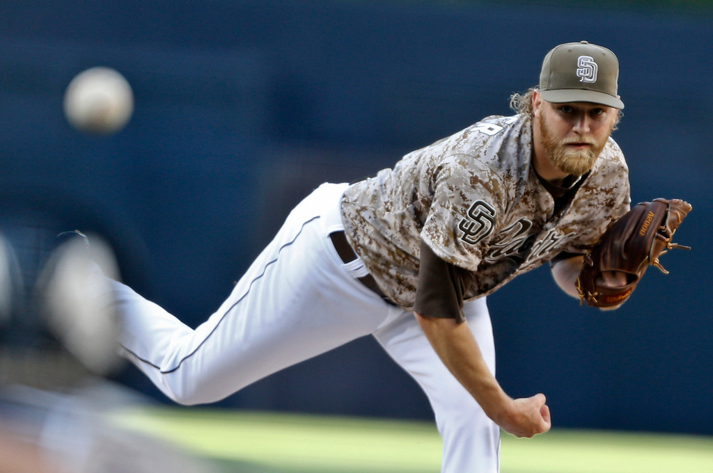 . San Diego Padres starting pitcher Andrew Cashner thorws against the Los Angeles Dodgers in the first inning of the opening game of Major League baseball in the United States Sunday, March 30, 2014, in San Diego.  (AP Photo/Lenny Ignelzi)