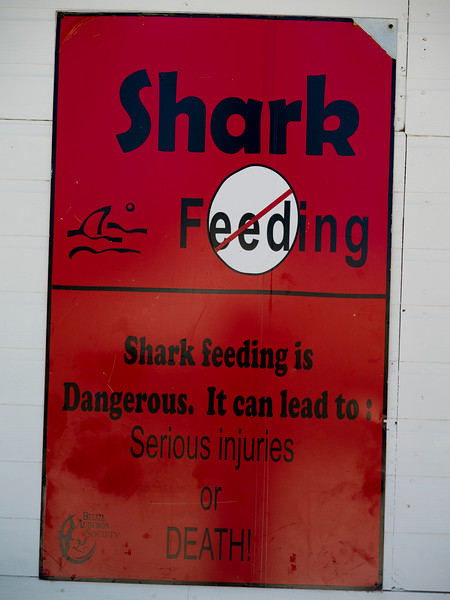 Close-up of warning sign, Half Moon Caye, Lighthouse Reef Atoll, Belize