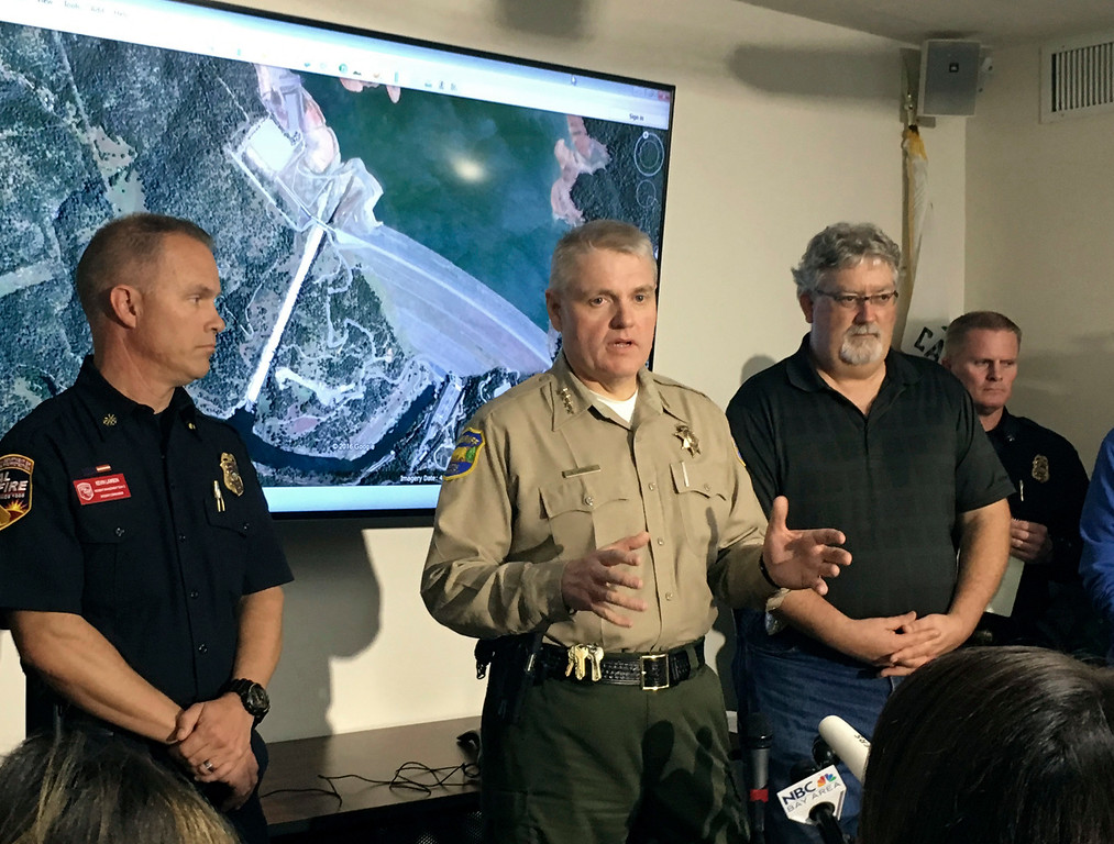 . Butte County Sheriff Kory Honea, center, speaks during a news conference in Oroville, Calif., Monday, Feb. 13, 2017. Honea said nearly 200,000 people who were ordered to leave their homes out of fear that a spillway could collapse may not be able to return until the barrier at the dam is repaired. (AP Photo/Jonathan J. Cooper)