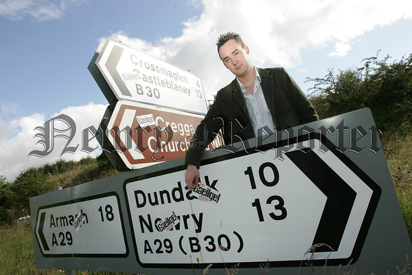 Unionist Party official Kenny Donaldson is pictured taking down some of the As Gaeilge Anois (Irish Now) stickers which have been placed on roadsigns throughout the Newry and Mourne Area. 07W30N18