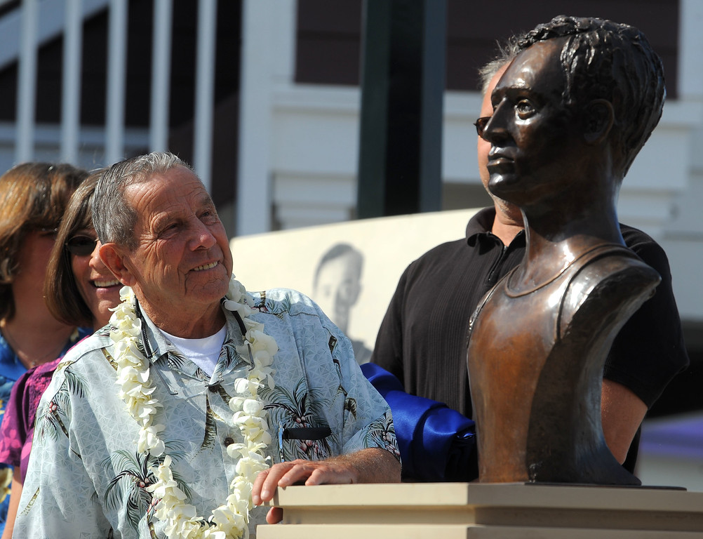 . REDONDO BEACH - 11/07/2010 - (Staff Photo: Scott Varley) Two years after it was stolen, a new bronze bust of surfing pioneer George Freeth was unveiled Sunday at the Redondo Beach Pier. Freeth is credited with bringing surfing from Hawaii to the mainland 100 years ago. Local waterman Bob Meistrell admires the new bust of Freeth.
