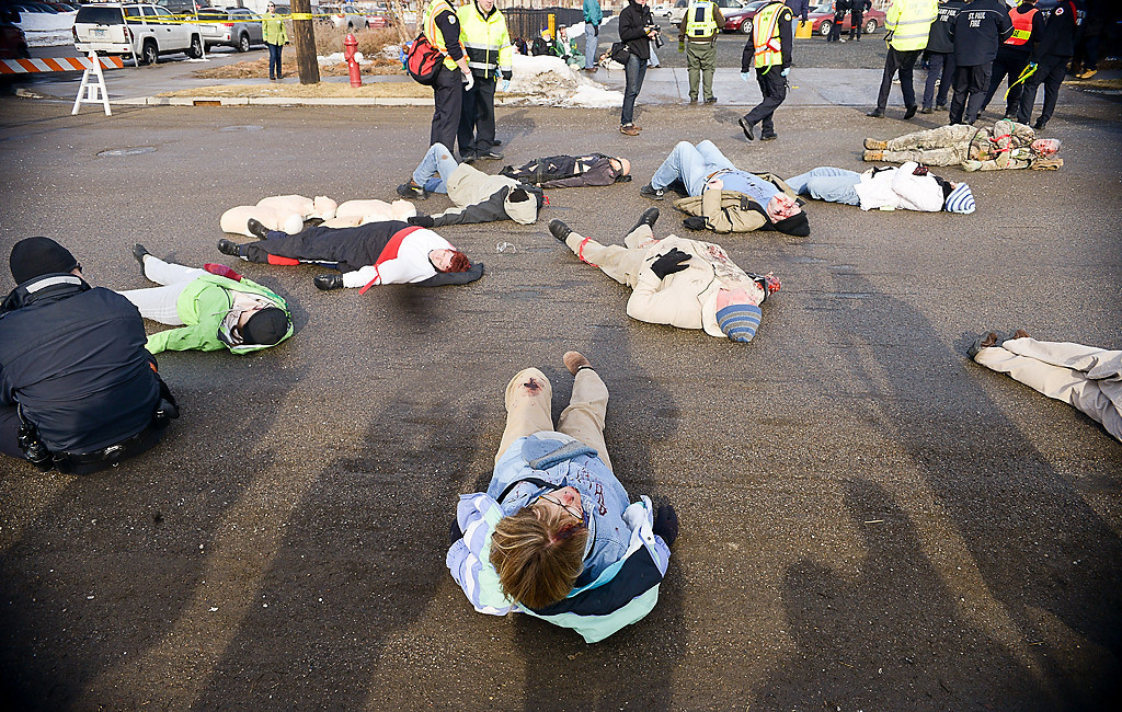 . Injured passengers are collected in a triage area during the full-scale emergency preparedness exercise. (Pioneer Press: Ben Garvin)