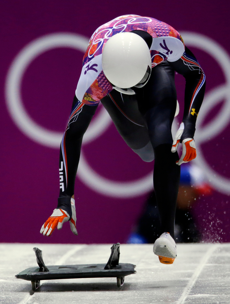 . Matthew Antoine of the United States starts his third heat during the men\'s skeleton competition at the 2014 Winter Olympics, Saturday, Feb. 15, 2014, in Krasnaya Polyana, Russia. (AP Photo/Dita Alangkara)