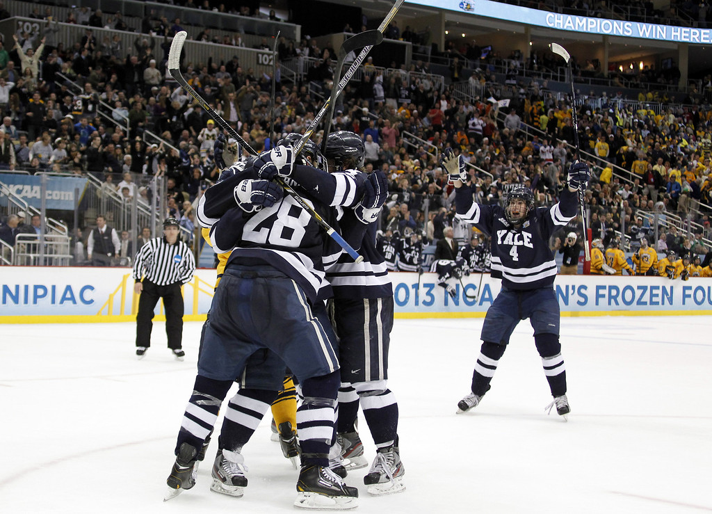 . PITTSBURGH, PA - APRIL 13:  Clinton Bourbonais #15 of the Yale Bulldogs celebrates his second period goal against the Quinnipiac Bobcats during the game at Consol Energy Center on April 13, 2013 in Pittsburgh, Pennsylvania.  (Photo by Justin K. Aller/Getty Images)
