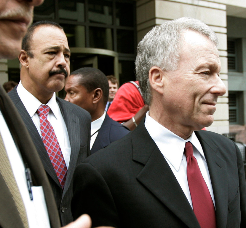 . Former White House aide I. Lewis \'Scooter\' Libby, right, is escorted to a waiting vehicle with his attorney, Theodore Well, center, outside federal Court in Washington, Thursday, June 14, 2007 after a federal judge said he will not delay a 2 1/2-year prison sentence for Libby in the CIA leak case, a ruling that could send the former White House aide to prison within weeks. (AP Photo/Pablo Martinez Monsivais)
