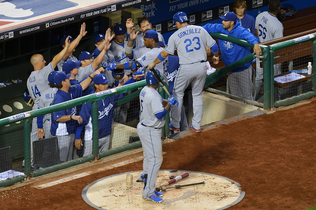 . PHILADELPHIA, PA - AUGUST 16: The Los Angeles Dodgers congratulate teammate Hanley Ramirez #13 on a two run home run in the fourth inning against the Philadelphia Phillies at Citizens Bank Park on August 16, 2013 in Philadelphia, Pennsylvania. (Photo by Drew Hallowell/Getty Images)