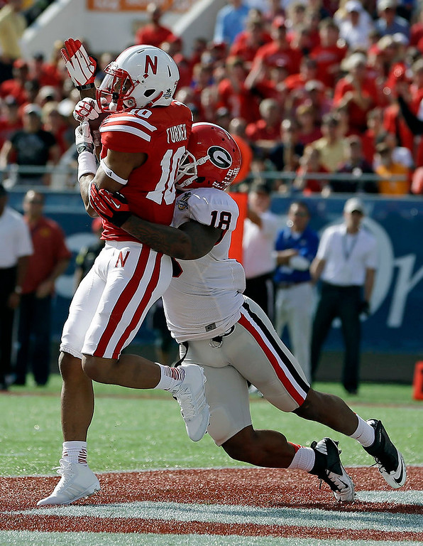 . Nebraska wide receiver Jamal Turner (10) catches a 14-yard touchdown pass in the end zone in front of Georgia safety Bacarri Rambo (18) during the first half of the Capital One Bowl NCAA football game, Tuesday, Jan. 1, 2013, in Orlando, Fla. (AP Photo/John Raoux)