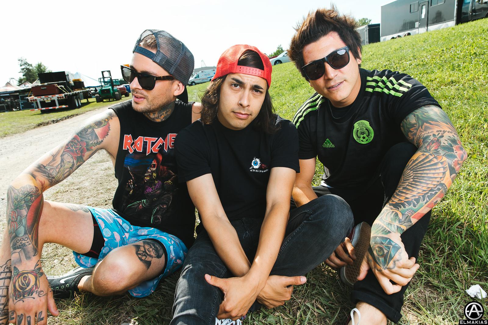 Mike Fuentes, Vic Fuentes, and Jaime Preciado of Pierce the Veil at Warped Tour 2015 by Adam Elmakias
