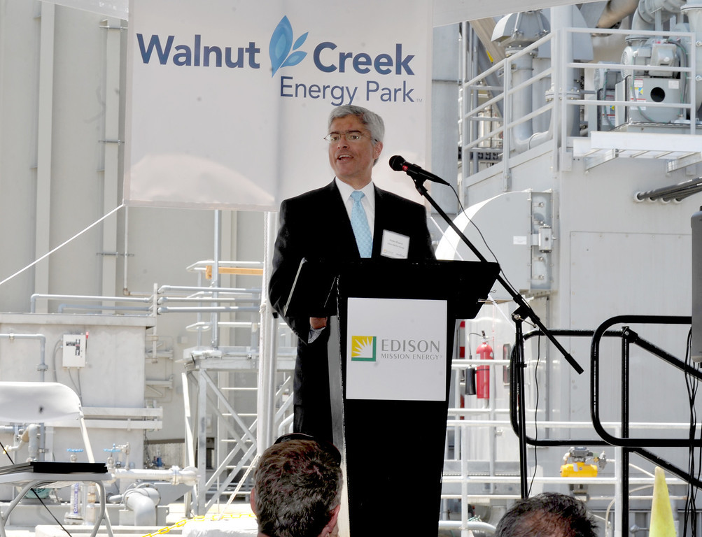 . Edison Mission Energy President Pedro Pizarro speaks as they dedicate the new Walnut Creek Energy Park in the City of Industry on Friday May 9, 2013. The 479 mega-watt project can produce enough energy to power 165,000 home air conditioning systems in the Los Angeles area. (SGVN/Staff Photo by Keith Durflinger)
