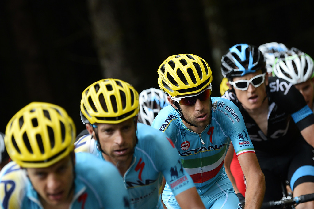 . Italy\'s Vincenzo Nibali (3rdL) rides behind his Astana teammates during the 161.50 km tenth stage of the 101st edition of the Tour de France cycling race on July 14, 2014 between Mulhouse and La Planche des Belles Filles ski resort, eastern France.  AFP PHOTO / LIONEL  BONAVENTURE/AFP/Getty Images