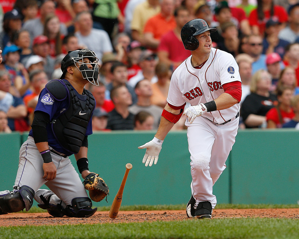 . Daniel Nava #29 of the Boston Red Sox knocks in a run against the Colorado Rockies in the 3rd inning at Fenway Park on June 26, 2013 in Boston, Massachusetts.  (Photo by Jim Rogash/Getty Images)