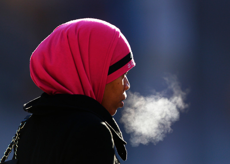 . A woman exhales in freezing temperatures,Thursday, Jan. 23, 2014, in Philadelphia. The National Weather Service said Tuesday\'s storm could brought 8 to 12 inches of snow to Philadelphia and New York City, and more than a foot in Boston. (AP Photo/Matt Rourke)