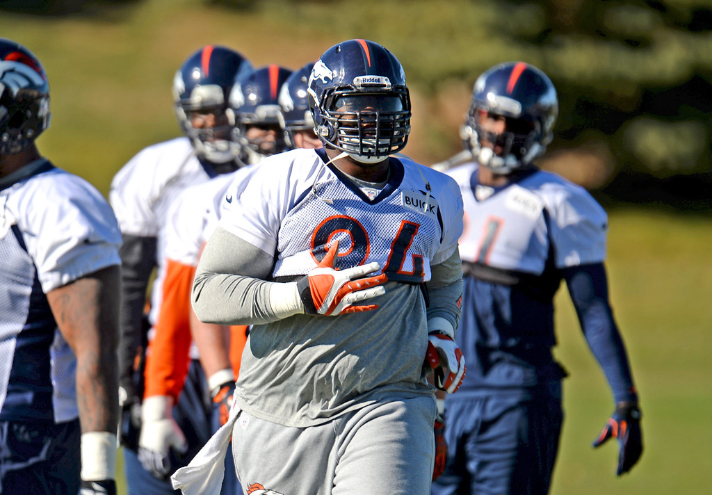 . Denver Broncos Terrance Knighton (94) is warming up for the team practice at Dove Valley practice field, Englewood, Colorado, November 15, 2013. (Photo by Hyoung Chang/The Denver Post)