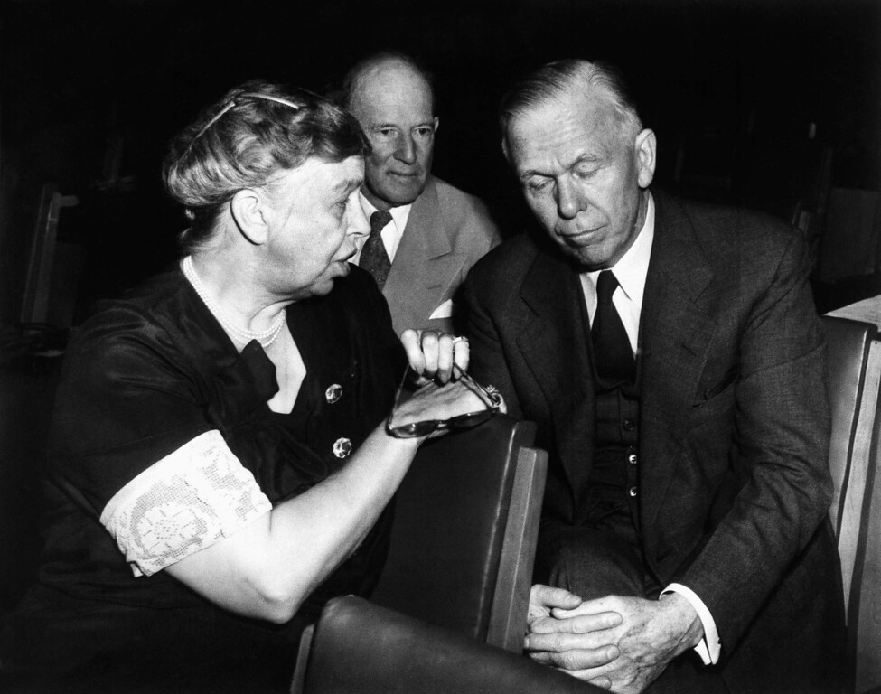 . 1947: George Marshall. Mrs. Eleanor Roosevelt, left, speaks as Secretary of State George C. Marshall, right, as Francis B. Sayre, center, alternate representative on the U.S. United Nations Delegation, listen during an informal huddle at the UN General Assembly, Sept. 17, 1947 at Flushing Meadows, New York. (AP Photo)