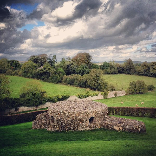 The sheep-speckled hills of Newgrange and the Brú na Bóinne Neolithic tomb chambers. This is Ireland.