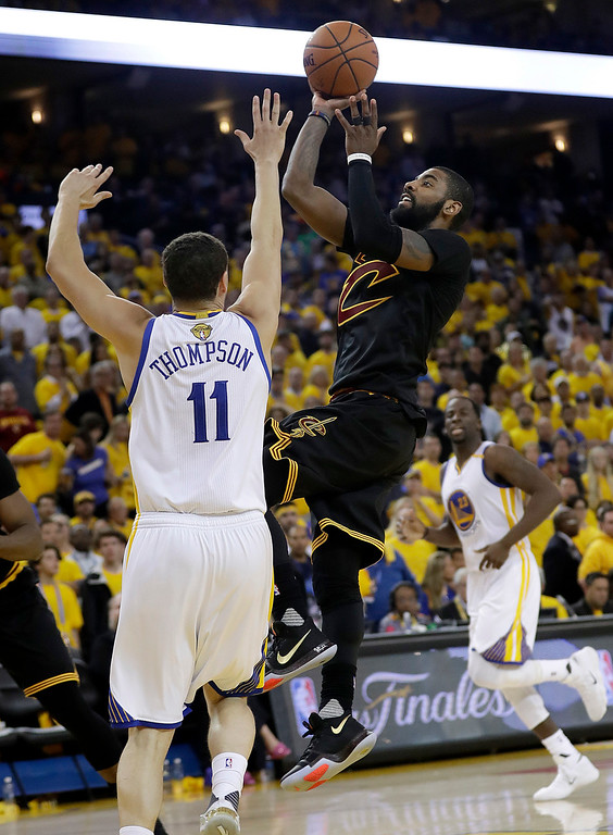 . Cleveland Cavaliers guard Kyrie Irving (2) shoots against Golden State Warriors guard Klay Thompson (11) during the second half of Game 5 of basketball\'s NBA Finals in Oakland, Calif., Monday, June 12, 2017. (AP Photo/Marcio Jose Sanchez)