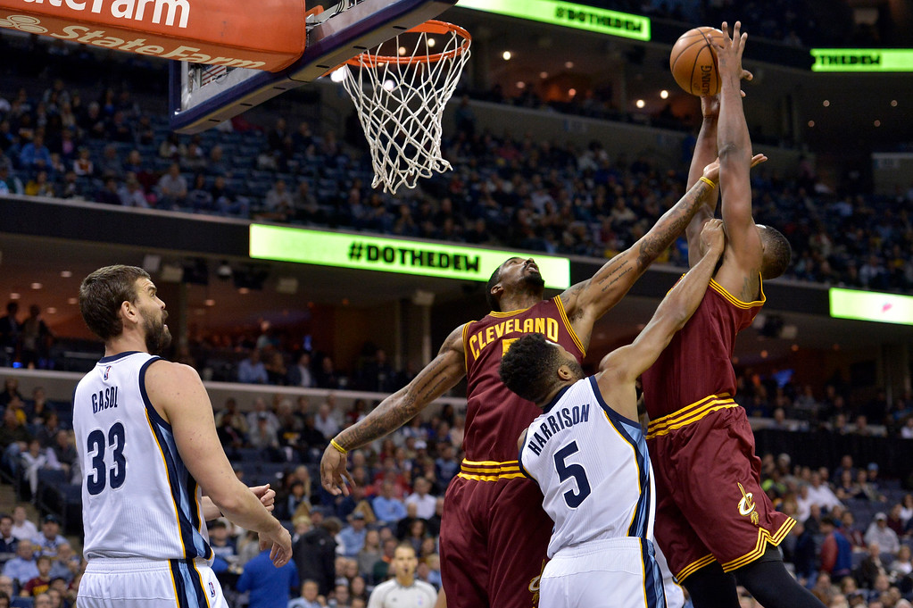 . Memphis Grizzlies center Marc Gasol (33) looks on as Cleveland Cavaliers guard J.R. Smith, from left, Grizzlies guard Andrew Harrison (5), and Cavaliers center Tristan Thompson (13) battle for a rebound in the first half of an NBA basketball game Wednesday, Dec. 14, 2016, in Memphis, Tenn. (AP Photo/Brandon Dill)