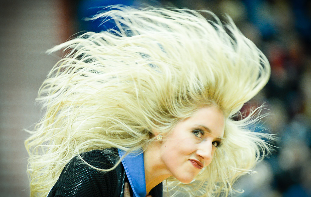 . A Timberwolves dancer performs during a timeout.