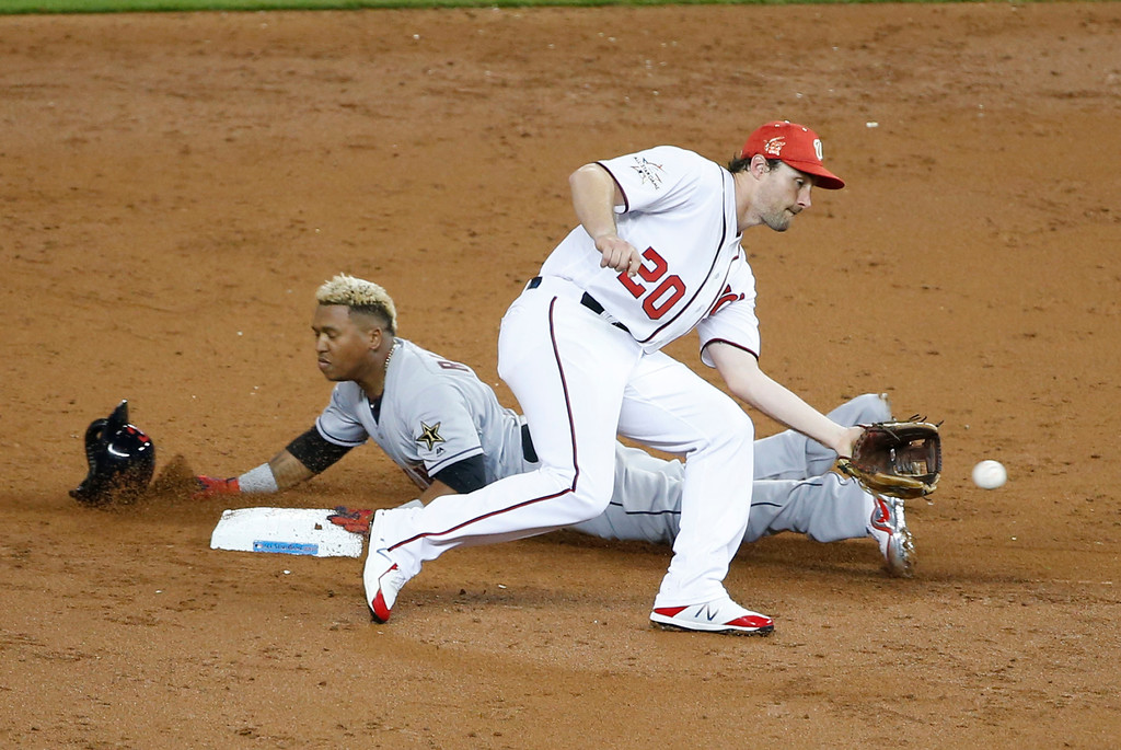 . American League\'s Cleveland Indians José Ramĺrez (11) steals second base as National League\'s Washington Nationals second baseman Daniel Murphy (20) is late with the tag, during the third inning, during the MLB baseball All-Star Game, Tuesday, July 11, 2017, in Miami. (AP Photo/Wilfredo Lee)