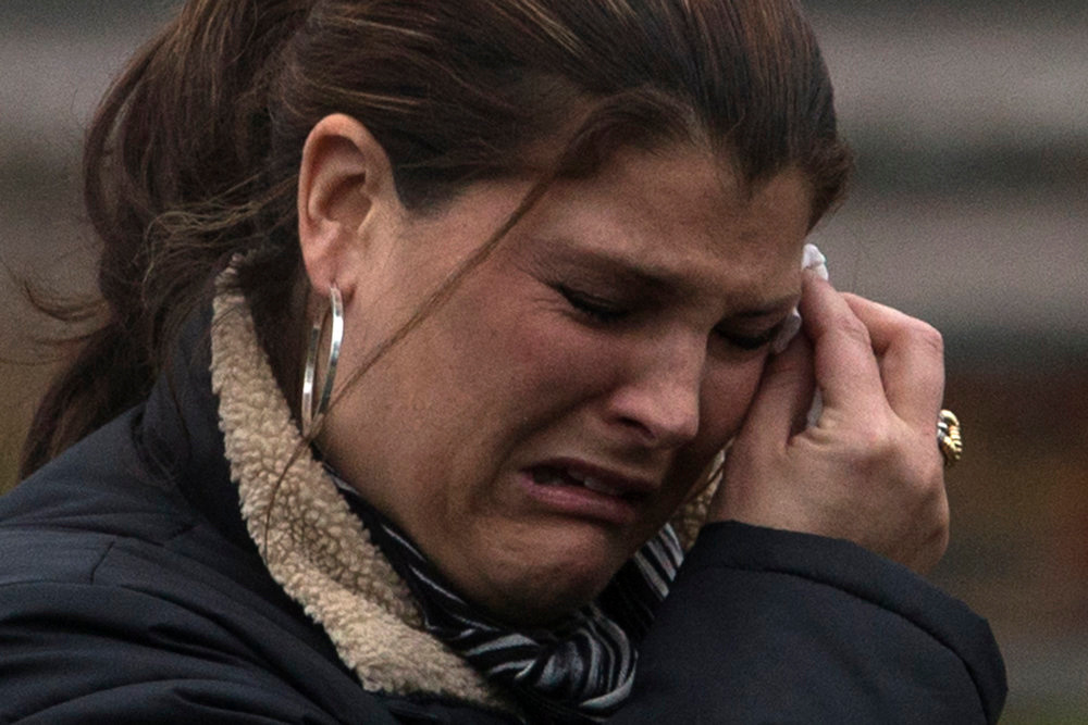 . A woman cries after taking part in funeral services for six-year-old Jack Pinto, one of 20 schoolchildren killed in the December 14 shootings at Sandy Hook Elementary School, in Newtown, Connecticut December 17, 2012. Two funerals on Monday ushered in what will be a week of memorial services and burials for the 20 children and six adults massacred at Sandy Hook Elementary School in Newtown, Connecticut. REUTERS/Adrees Latif