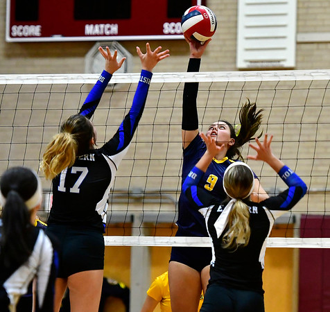 11/14/2018 Mike Orazzi | Staff Bristol Eastern's Gabriella Nozzolillo (17) and Woodstock Academy's Paula Hernandez Aulet (9) during the Class L Semifinal State Girls Volleyball Tournament held at Windsor High School Wednesday night.