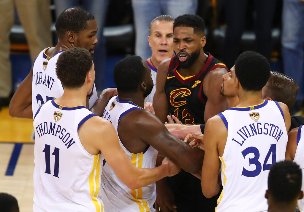 . Cleveland Cavaliers center Tristan Thompson, facing, confronts Golden State Warriors forward Draymond Green, second from bottom left, during overtime of Game 1 of basketball\'s NBA Finals in Oakland, Calif., Thursday, May 31, 2018. The Warriors won 124-114. (AP Photo/Ben Margot)