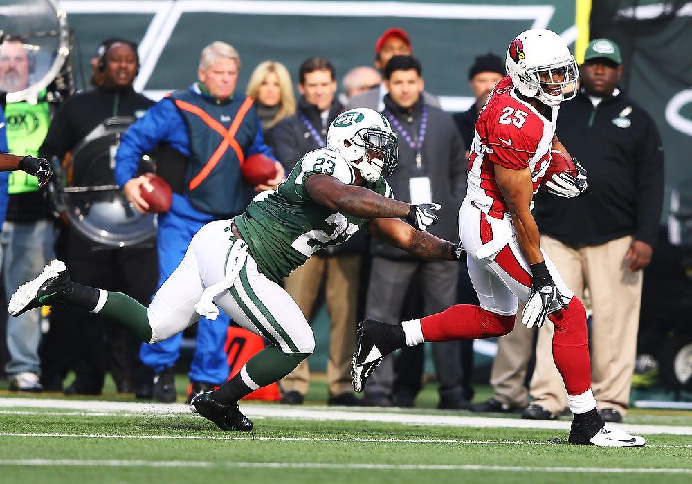 . Kerry Rhodes #25 of the Arizona Cardinals returns an interception as  Shonn Greene #23 of the New York Jets pursues during their game at at MetLife Stadium on December 2, 2012 in East Rutherford, New Jersey.  (Photo by Al Bello/Getty Images)