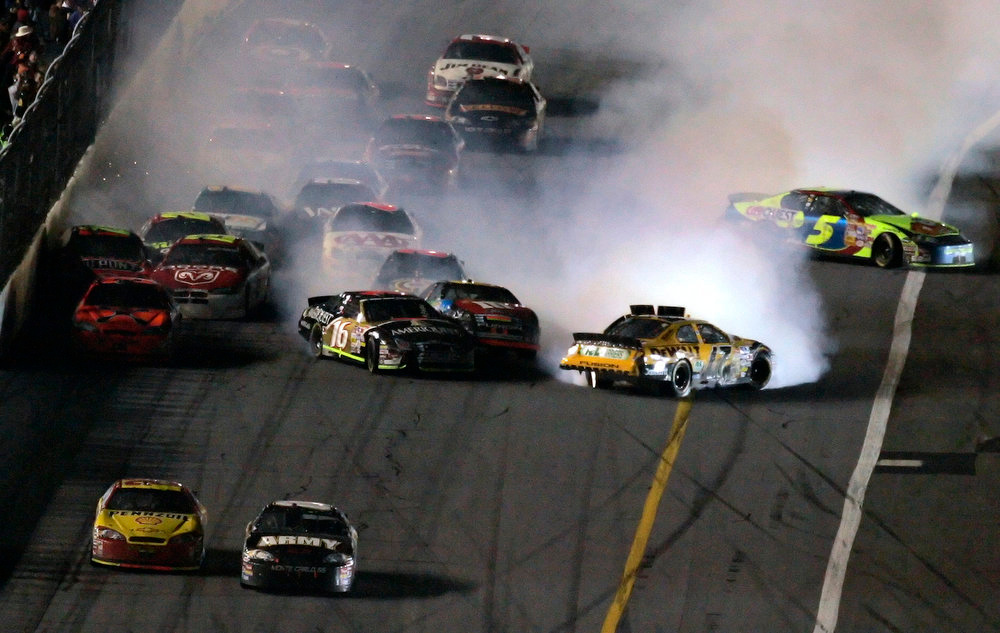 Description of . NASCAR driver Kevin Harvick, lower left, and Mark Martin, lower right, battle for the finish line as a multi-car crash happens behind them during the Daytona 500 race Sunday afternoon Feb. 18, 2007 at the Daytona International Speedway in Daytona Beach, Fla. Harvick won the race. (AP Photo/Chris O'Meara)