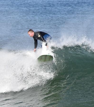 Surfers at Nantasket during high waves...