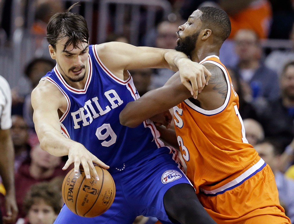 . Philadelphia 76ers\' Dario Saric (9), from Croatia, drives past Cleveland Cavaliers\' Tristan Thompson in the first half of an NBA basketball game, Friday, March 31, 2017, in Cleveland. (AP Photo/Tony Dejak)