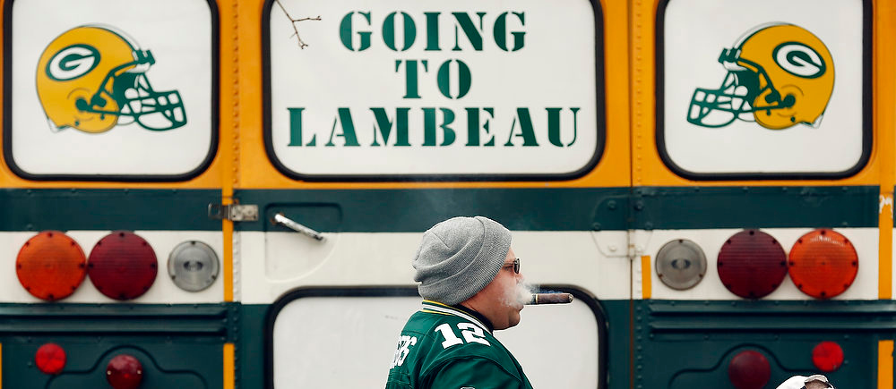 . Thane Westermeyer smokes a cigar outside Lambeau Field before an NFL football game between the Green Bay Packers and the Minnesota Vikings Sunday, Dec. 2, 2012, in Green Bay, Wis. (AP Photo/Tom Lynn)