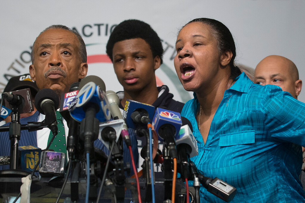 . Esaw Garner, right, wife of Eric Garner, responds to a question during a news conference at the National Action Network headquarters in New York on Wednesday, Dec. 3, 2014 after a grand jury\'s decision not to indict a New York police officer involved in her husband\'s death. A video shot by an onlooker and widely viewed on the Internet showed the 43-year-old Garner telling a group of police officers to leave him alone as they tried to arrest him. The city medical examiner ruled Garner\'s death a homicide and found that a chokehold contributed to it. At left is Rev. Al Sharpton. (AP Photo/John Minchillo)