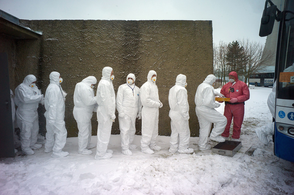 . Workers of Dukovany nuclear power plant dressed in radiation protection suits get on a bus during a nuclear accident exercise on March 26, 2013 in Dukovany nuclear power plant, 50km from the city of Brno. MICHAL CIZEK/AFP/Getty Images