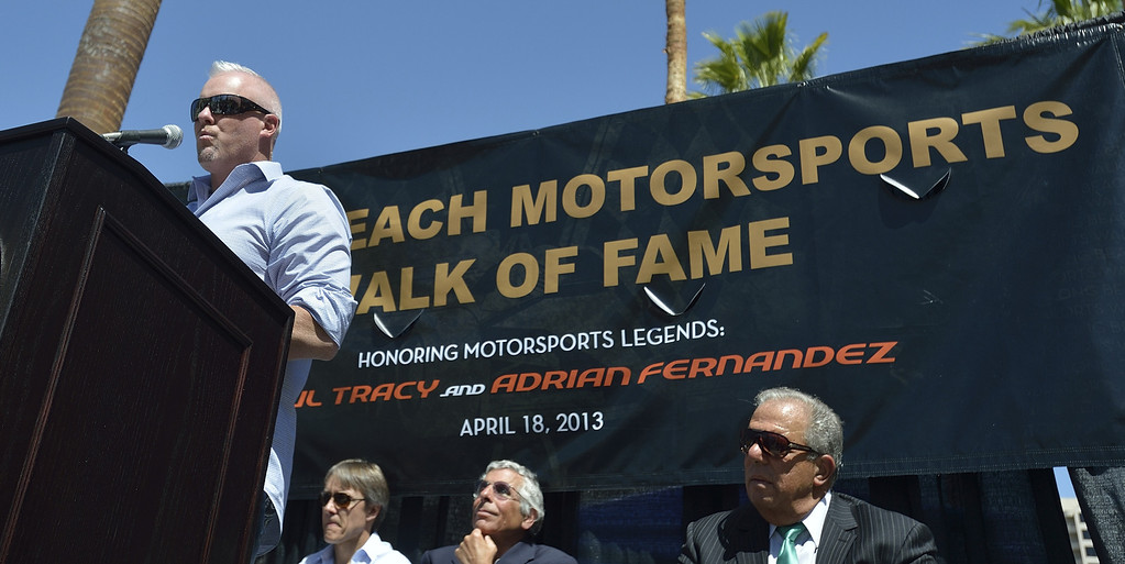. LONG BEACH, CALIF. USA --  Paul Tracy talks about earning a spot on the Long Beach (Calif.) Motorsports Grand Prix Walk of Fame as fellow driver Adrian Fernandez, left, Jim Michaelian, President & CEO of the Long Beach Grand Prix and Mayor Bob Foster, right, listen during the induction ceremony on April 18, 2013. This year include Paul Tracy of Canada and Adrian Fernandez of Mexico. The annual Long Beach Motorsports Walk of Fame induction ceremony occurs in April of each year the Thursday before Toyota Grand Prix of LongBeach raceweekend. Photo by Jeff Gritchen / Los Angeles Newspaper Group