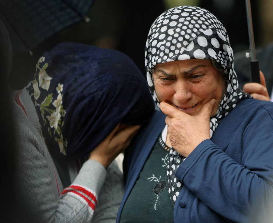 . Mourning relatives cry as pallbearers carry the coffin of Fehmi Karaca, 69, a shop owner and one 46 victims killed in Saturday explosions for burial in Reyhanli, near Turkey\'s border with Syria, Sunday, May 12, 2013. The bombings marked the biggest incident of cross-border violence since the start of Syria\'s bloody civil war and have raised fear of Turkey being pulled deeper into the conflict. (AP Photo/Burhan Ozbilici)