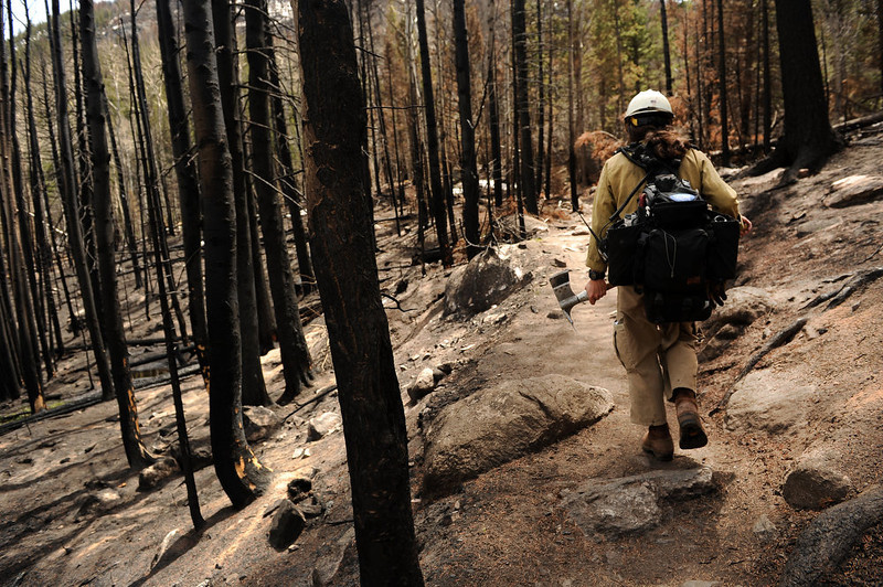 . Mark Mendonca, a Captain with the Alpine Hotshots, hikes through burned areas of the Fern Lake fire burned areas along the Cub Lake trail in Rocky Mountain National Park on May 13, 2013.    (Photo by Helen H. Richardson/The Denver Post)