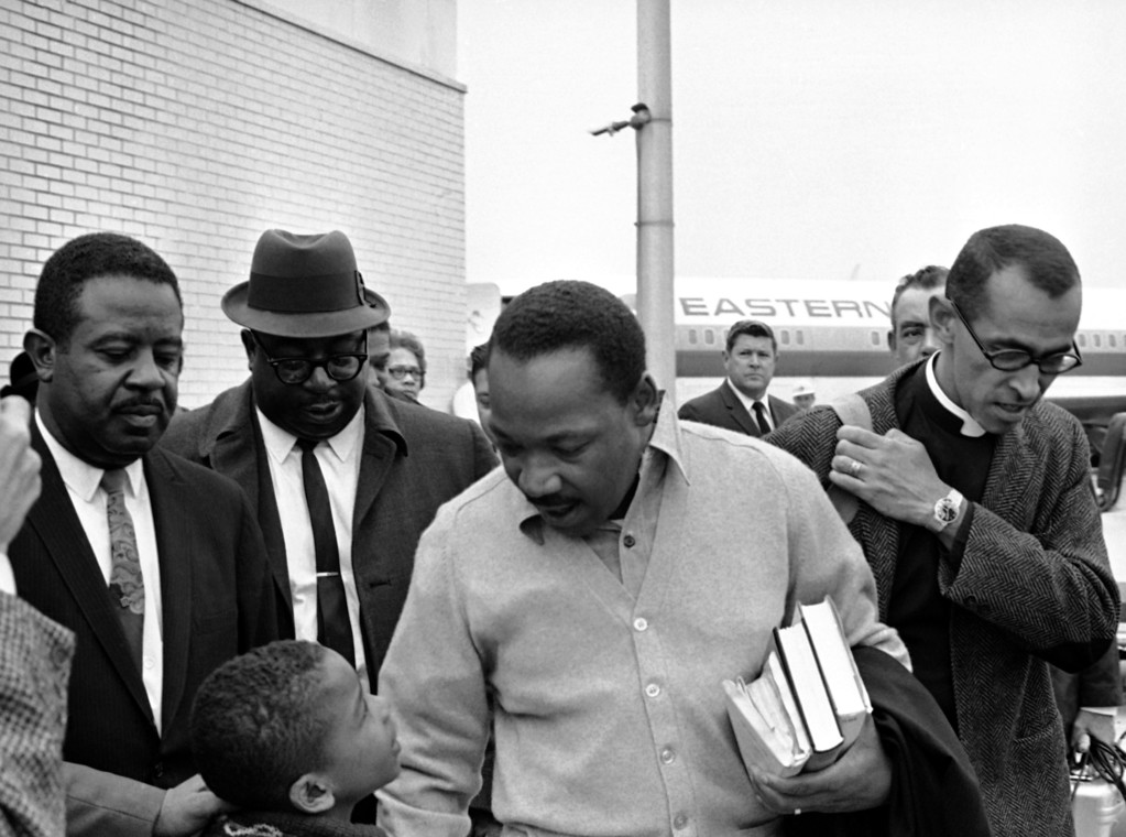 . Dr. Martin Luther King Jr., carries books as he heads toward the airplane that was to take him from Atlanta to Birmingham, Oct. 30, 1967 where he faced a 5-day jail for parading against court orders during 1963 civil rights demonstrations in the Alabama. With King for the trip - and the jail term - were, from left, the Rev. A.D. King, Ralph Abernathy and Wyatt Tee Walker. (AP Photo)