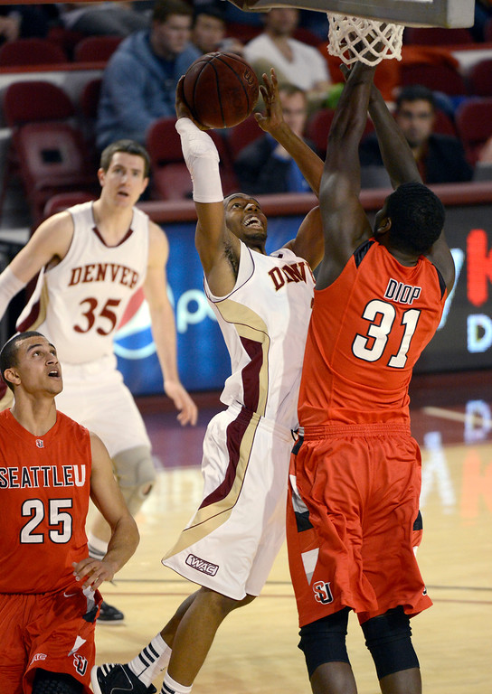 . DENVER, CO. - FEBRUARY 07: Jalen Love (3) of the Denver Pioneers goes up for a shot on Tidjane Diop (31) of the Seattle Redhawks during the second half February 7, 2013 at Magness Arena.The Denver Pioneers defeated the Seattle Redhawks 72-55. (Photo By John Leyba/The Denver Post)