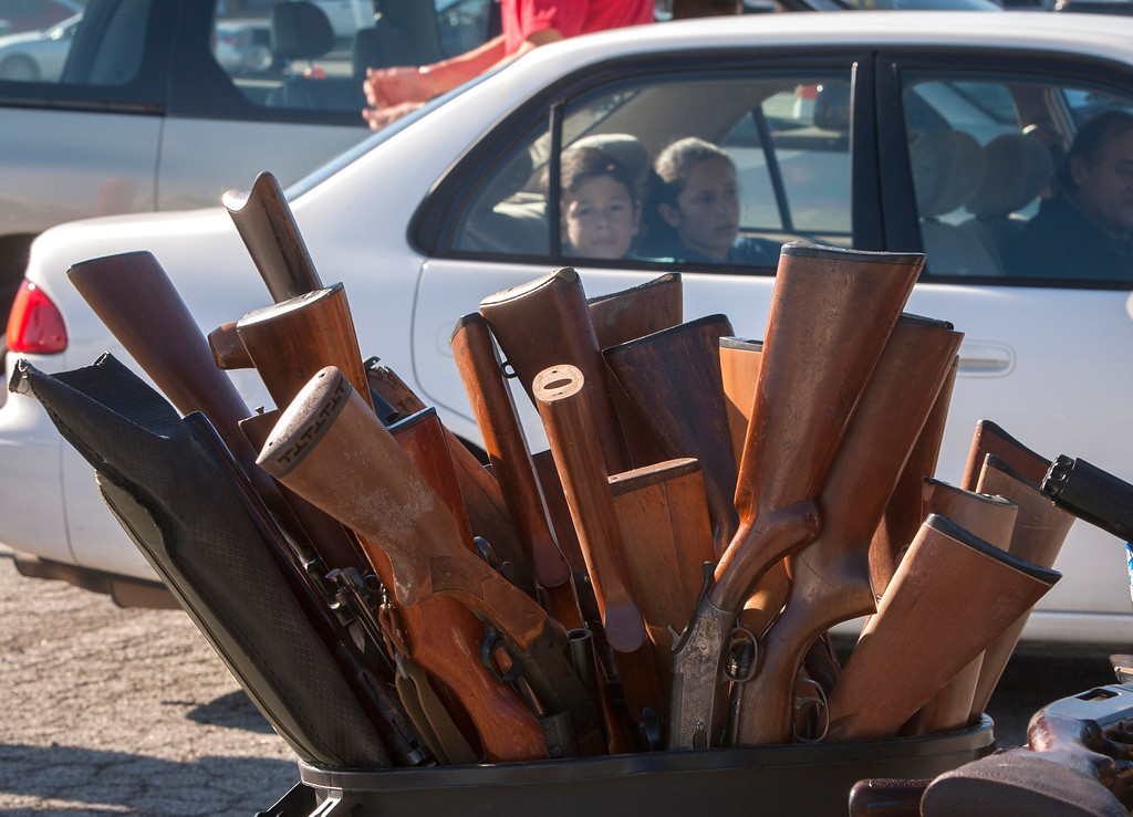 . Some of the hundreds of guns that were turned in during an anonymous gun buyback at the San Mateo County Event Center in San Mateo, Calif., on Saturday, Jan. 26, 2013. (John Green/Staff)