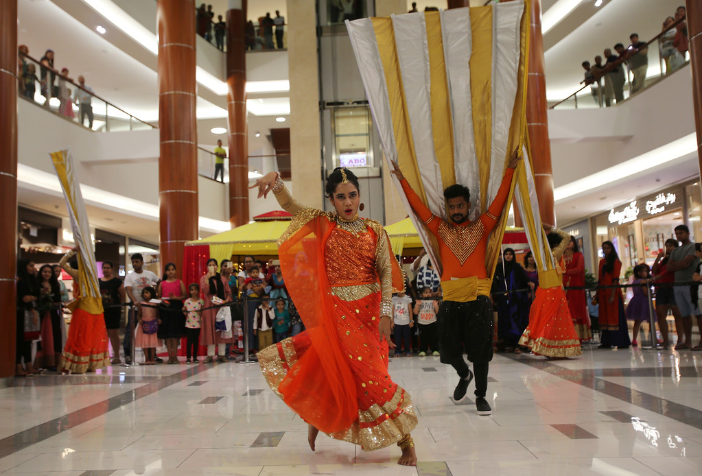 . Indian dancers perform at a shopping mall during Diwali, the Hindu festival of lights, in Dubai, United Arab Emirates, Thursday, Oct. 19, 2017. (AP Photo/Kamran Jebreili)