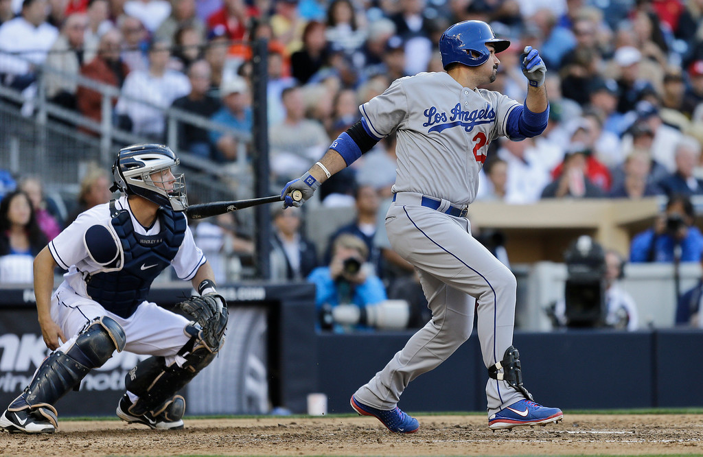 . Los Angeles Dodgers\' Adrian Gonzalez strokes a game tying single to left against the San Diego Padres during the seventh inning of a baseball game in San Diego, Tuesday, April 9, 2013. Nick Hundley is the Padres\' catcher.(AP Photo/Lenny Ignelzi)