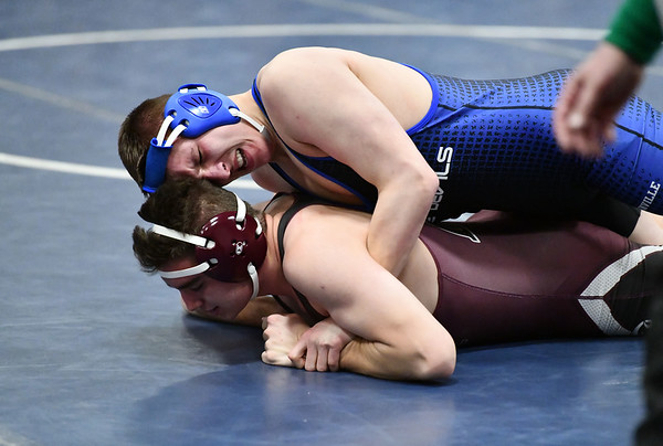 1/8/2020 Mike Orazzi | StaffrBristol Central's Matt Beaucar and Plainville's Esteban Torres during Wednesday night's match.