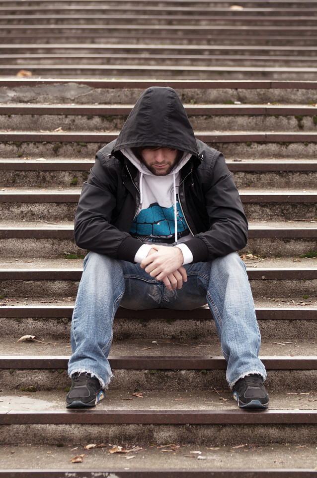 //www.dreamstime.com/royalty-free-stock-photography-sad-teenage-boy-hood-sitting-stairs-image23626807